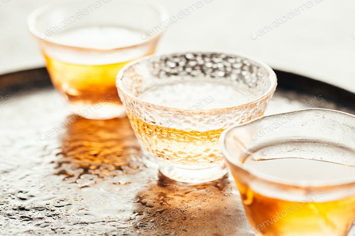 Fresh tea in glass cups on tray