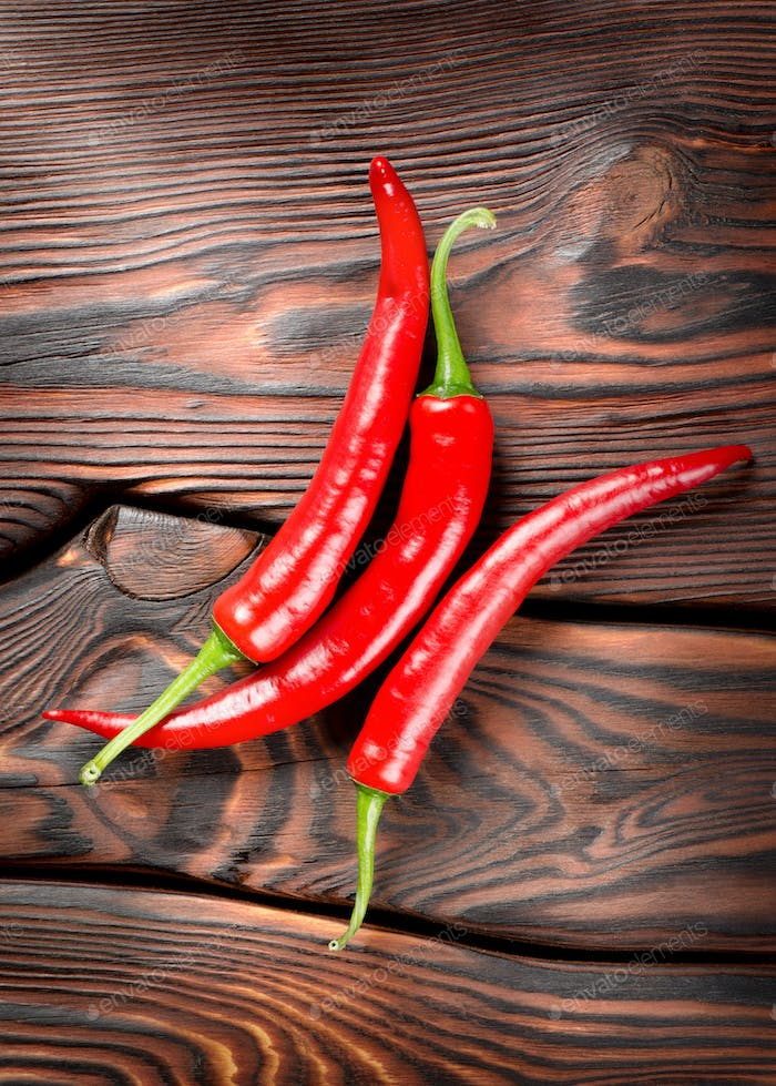 Chili on a wooden background
