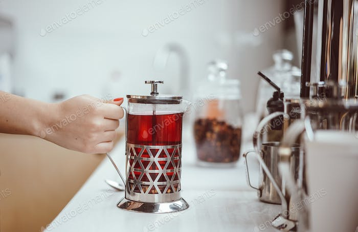 fresh berry tea in French press on the table