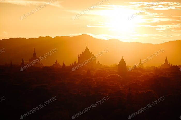 Scenic sunset view of ancient temples silhouettes in Bagan, Myanmar
