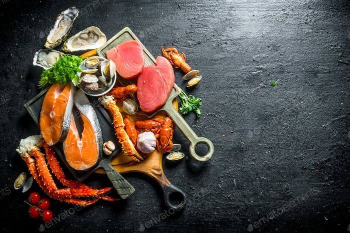 Salmon and tuna steaks with a variety of seafood and herbs.