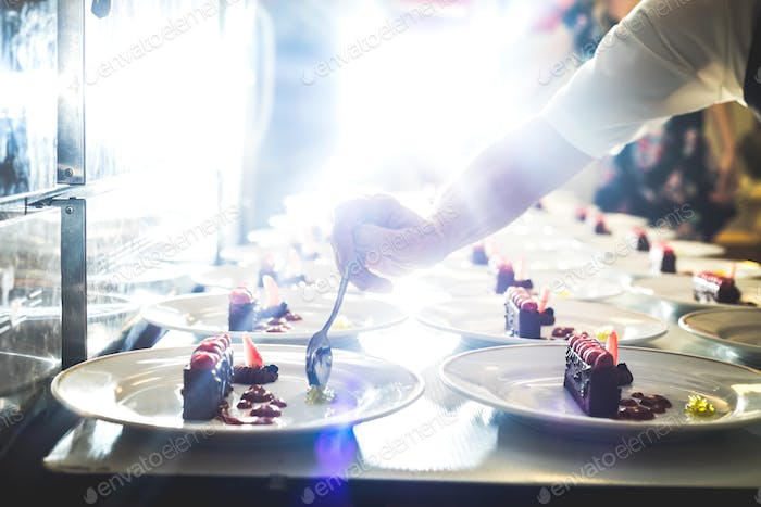 Caterer serving desserts in restaurant