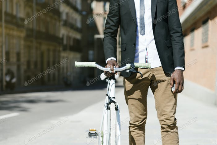 Handsome african man on bike in the city.