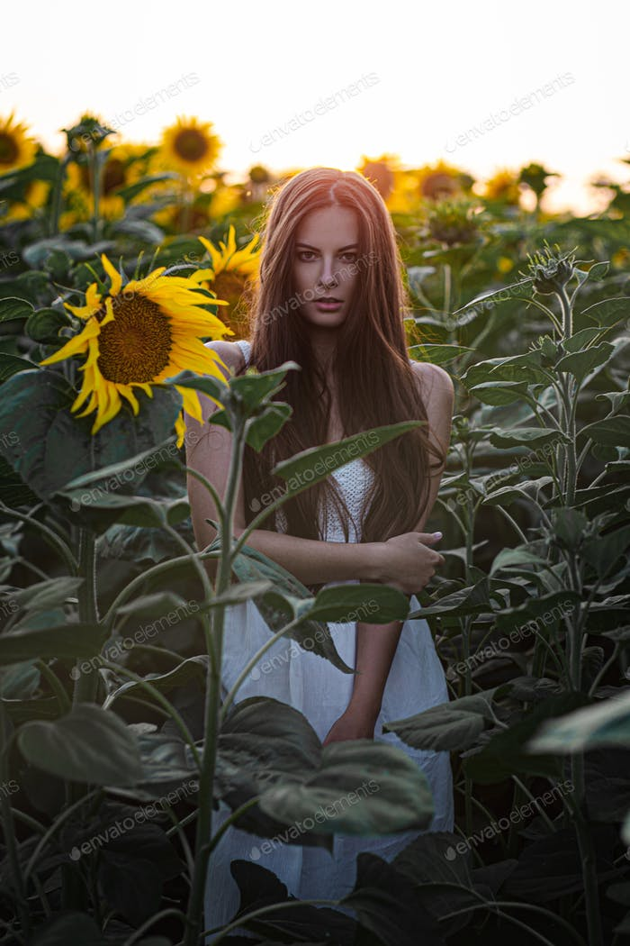 Beautiful girl portrait with sunflowers