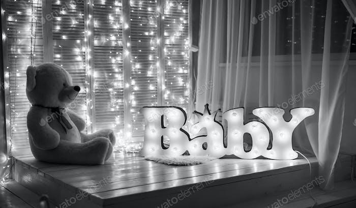 beautiful nursery with a teddy bear