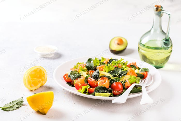 Salmon Salad with Vitamins in vegetables, herbs and avocado