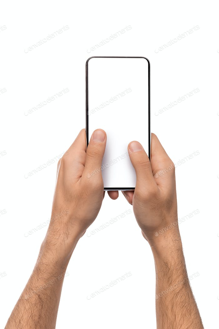 Man holding blank modern smartphone with two hands