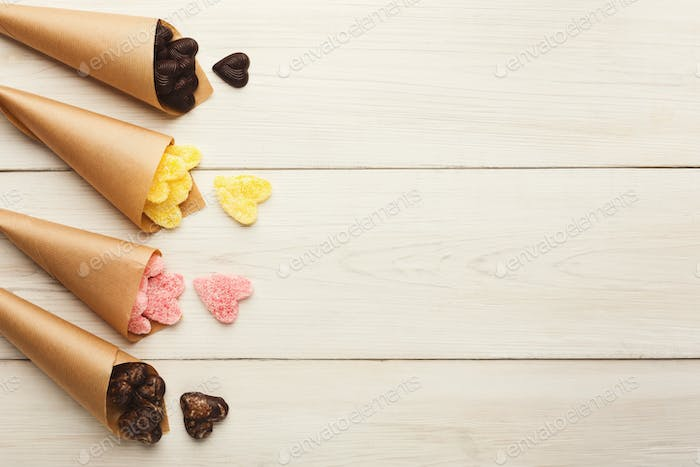 Lovers day background with various sweets in craft cornets