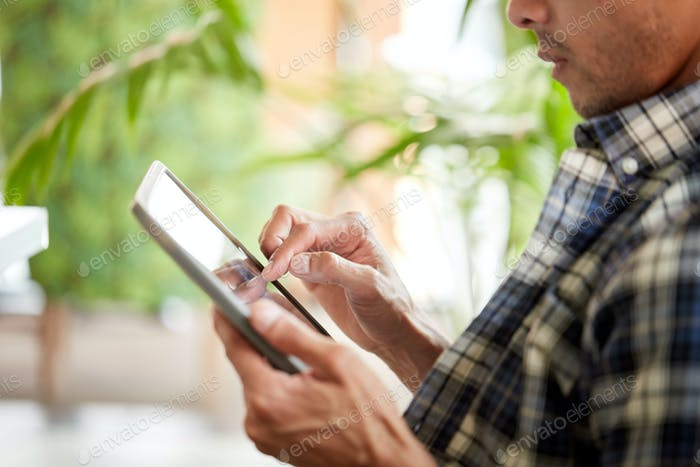 close up of man with tablet pc