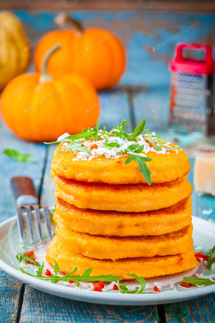 Pumpkin pancakes with chili pepper, parmesan cheese and rocket
