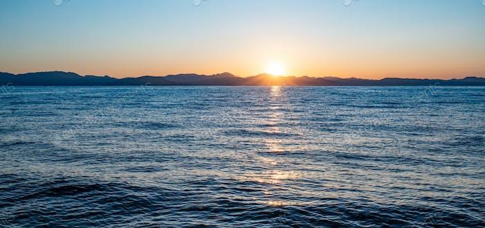 Sunset on Corfu Island in Ionian sea. Greece