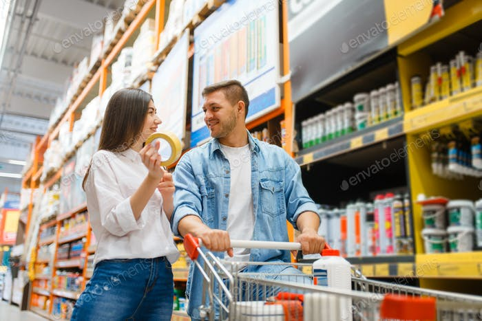 Couple with a cart buying building materials