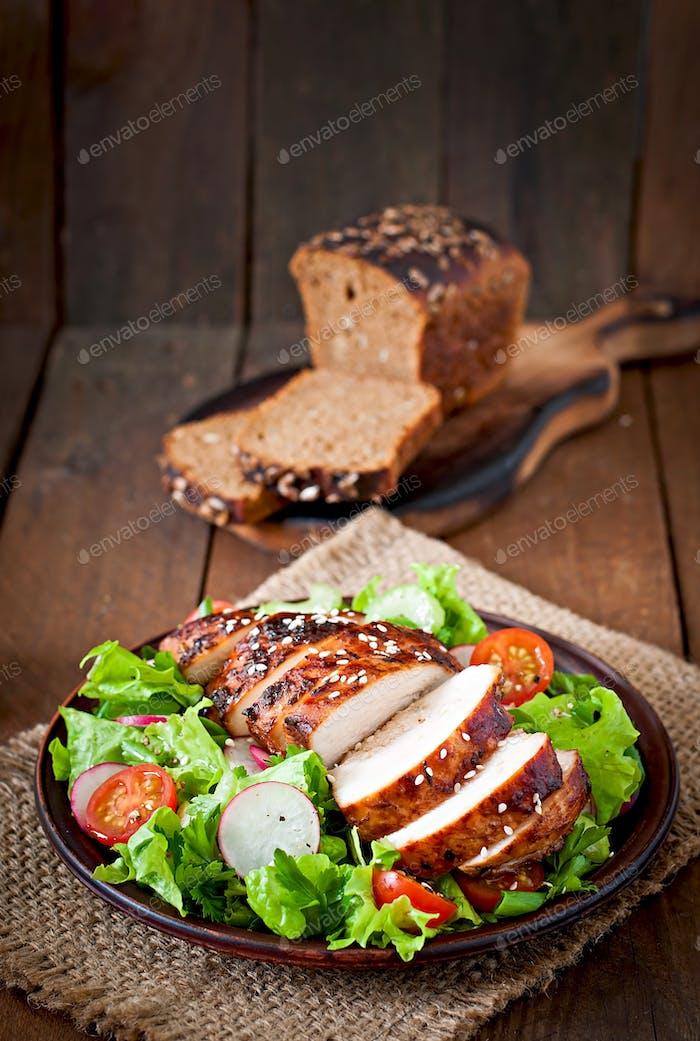 Fresh vegetable salad with grilled chicken fillet