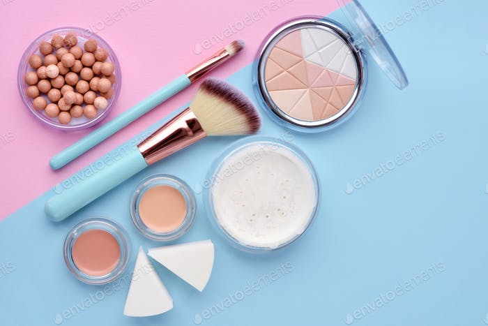 Makeup brush and decorative cosmetics on color background. Minim
