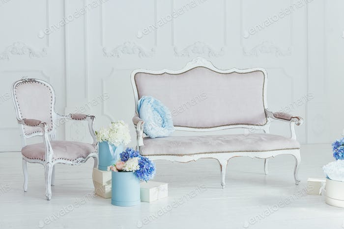 Light vintage style sofa and armchair
