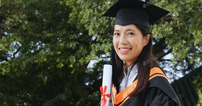 Woman get graduation and holding paper certificate