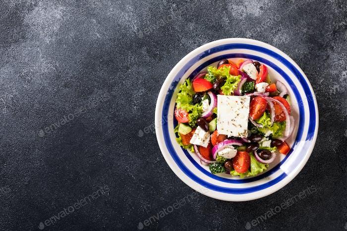 Greek salad of fresh vegetables, olives and feta. Traditional Mediterranean food.