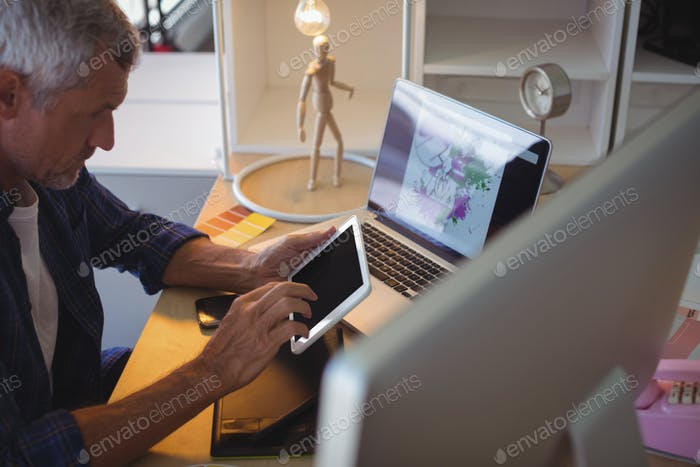 businessman using digital tablet at creative office