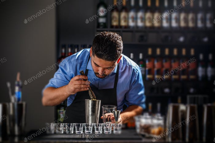 Bartender preparing an alcoholic beverage