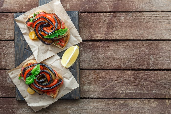 Two Bruschettas with grilled eggplant and bell peppers top view, place for text