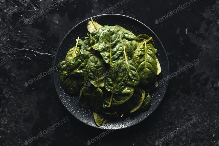 Vegetarian green spinach, leaves of spinach in dark deep colors, Vegan, wholesome foods