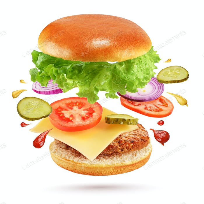 Flying cheeseburger isolated on white background