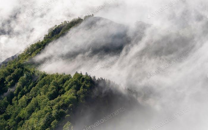 Fog rolling over hills at sunrise