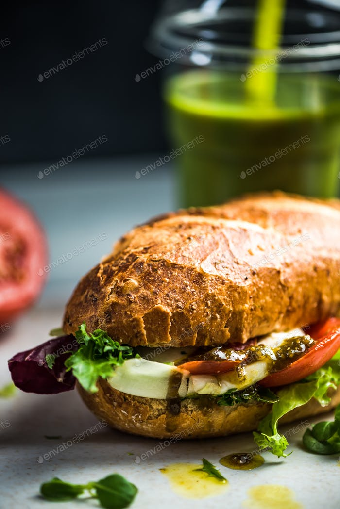 Diet vegetarian sandwich bun with smoothie, breakfast
