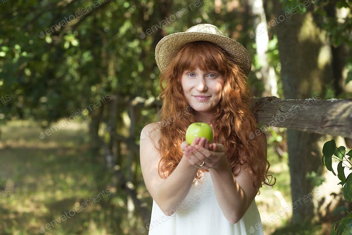 Country woman holding an apple