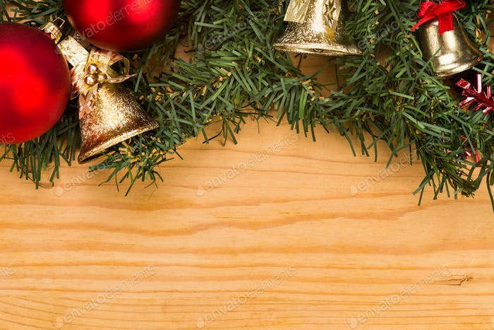 Simple wooden Christmas background with fir tree, ornaments and