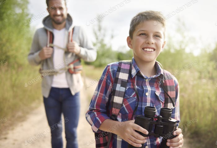 Boy discovering world with his father