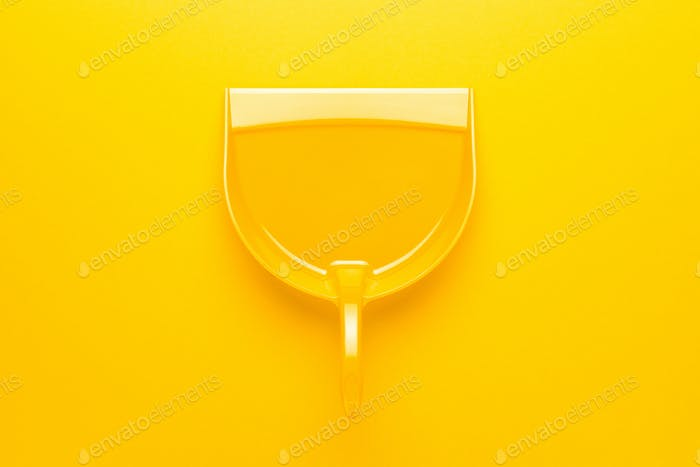 Plastic Dustpan on Yellow Background