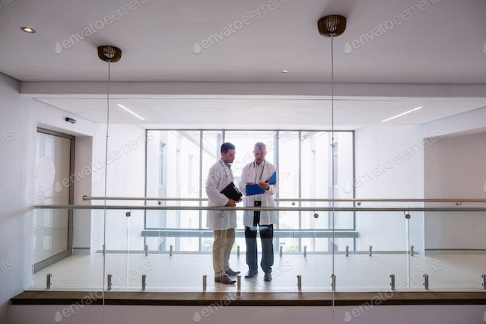 Two doctors discussing over reports
