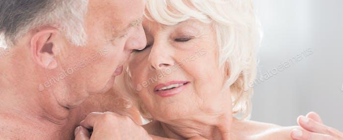 Senior couple cuddling and kissing