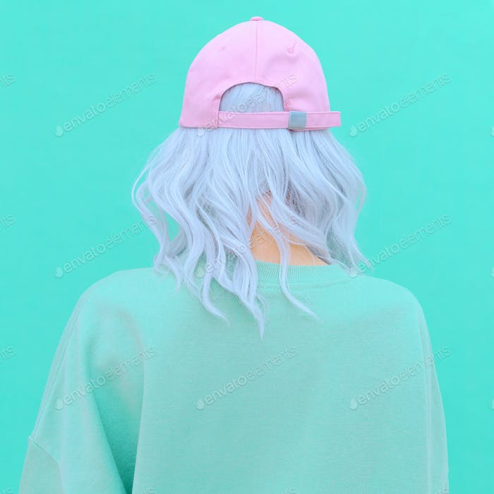 Aesthetic girl in stylish accessories b-boy cap. Fresh pastel colours monochrome fashion design