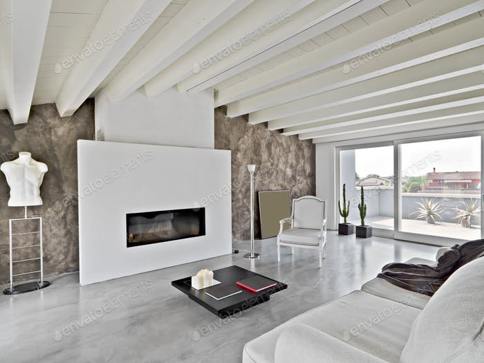 Interiors of a Modern Living Room With Fireplace in the Attic Room