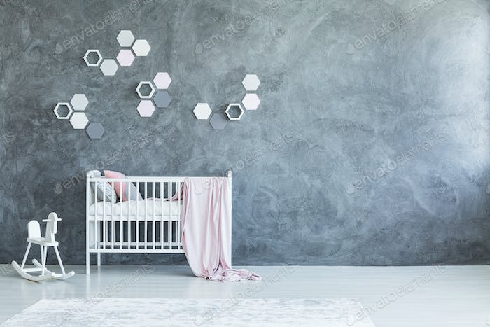 Grey baby's room with honeycombs
