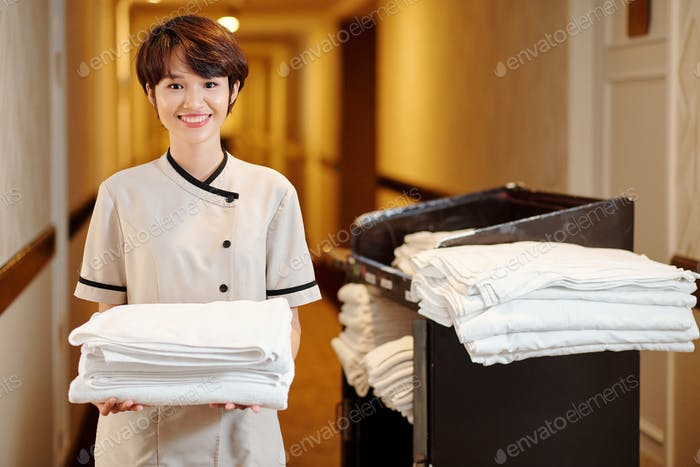 Hotel maid holding towels