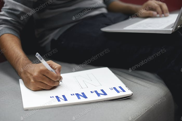 Startup Business People Writing on Notebook