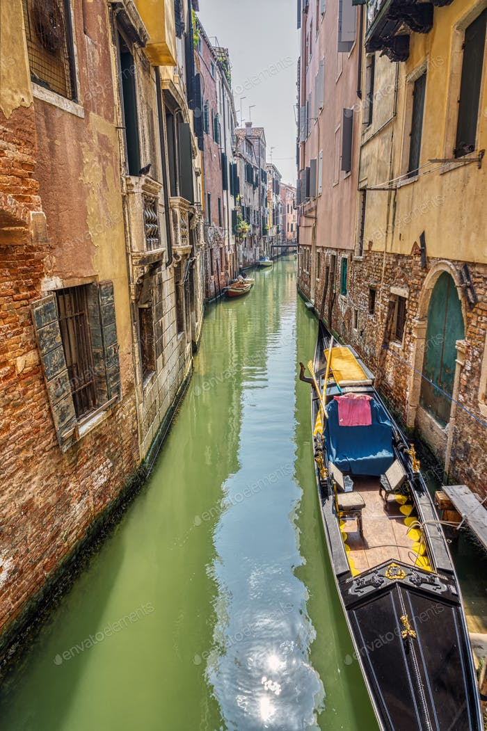 Small canal with traditional gondola
