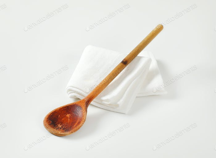 Old wooden stirring spoon