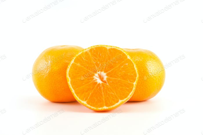 mandarins or tangerines and a slice
