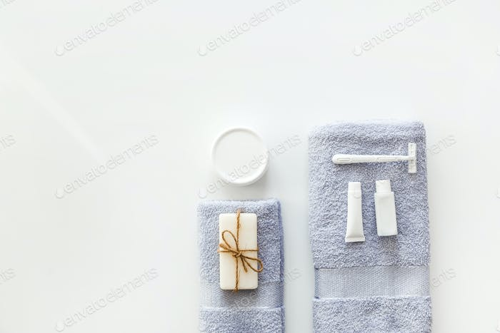 Body and skin hygienic care toiletry spa accessories, on white background. Flat lay. Copy space