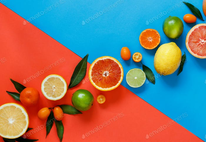 Citrus fruits on a red and blue background