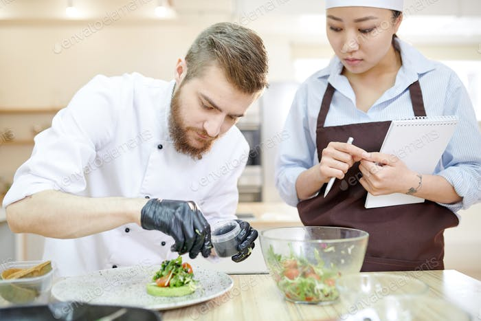 Handsome Chef Plating Dishes