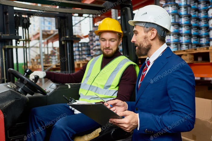 Warehouse Manager Instructing Mover
