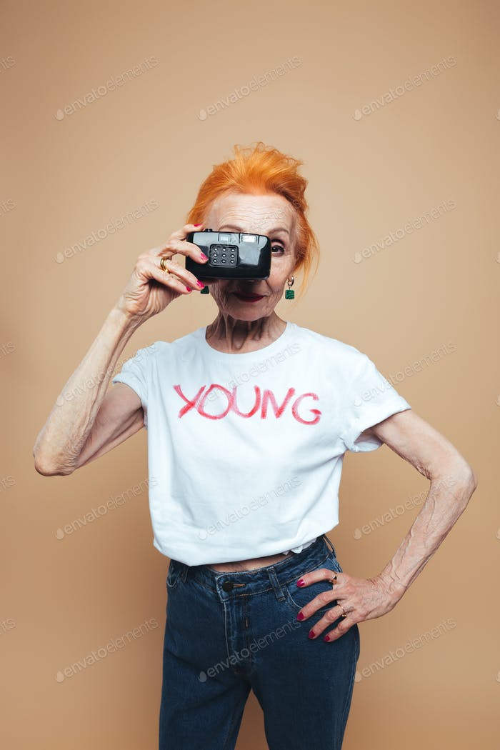 Gorgeous mature redhead fashion woman