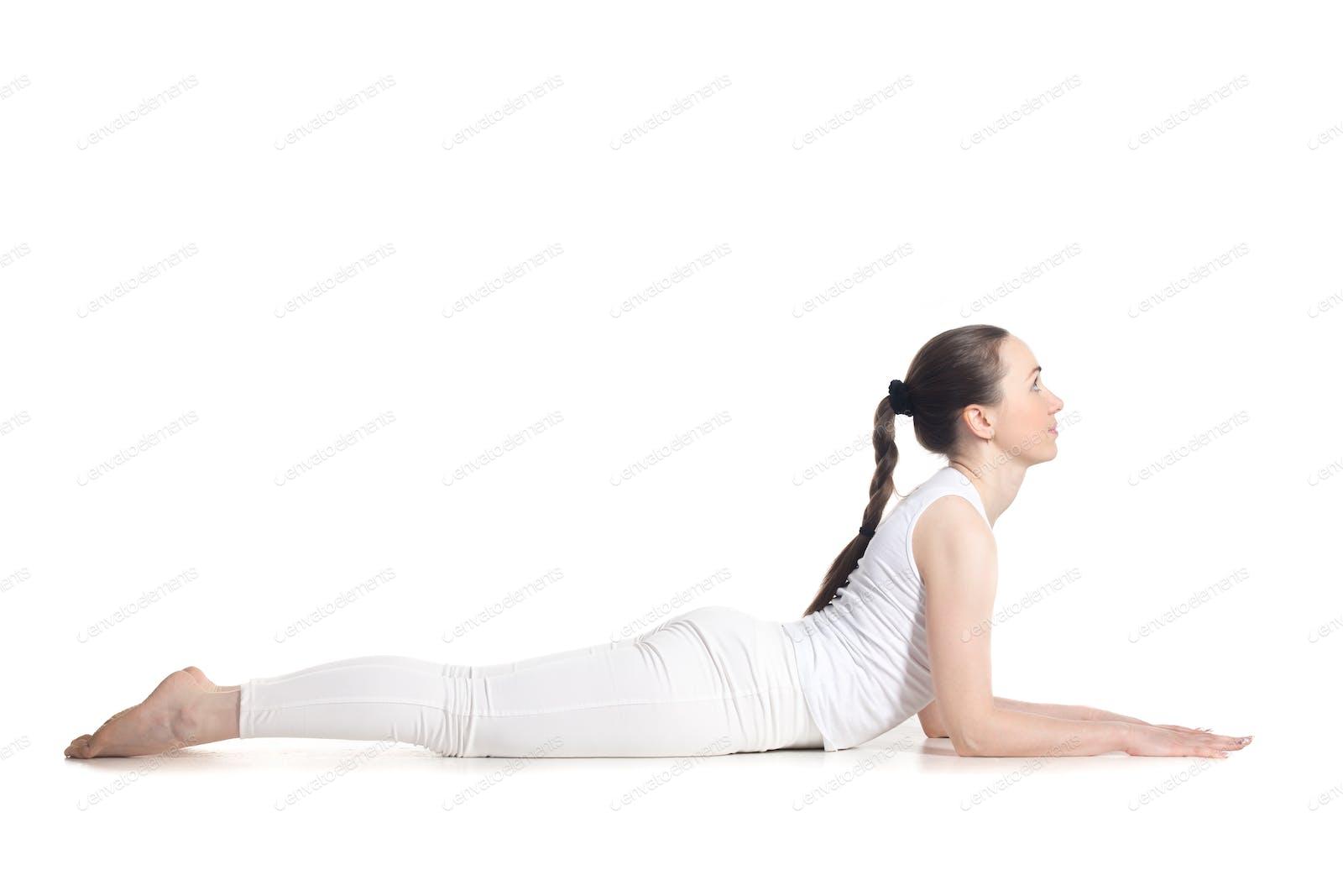 Sphinx yoga Pose photo by fizkes on Envato Elements