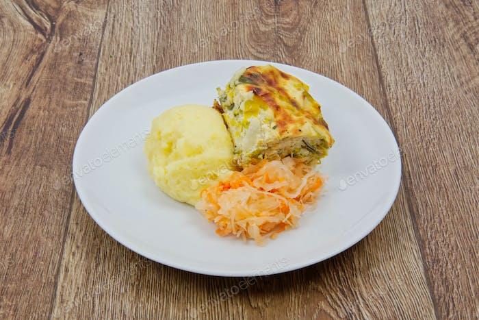 Leek lasagna and potato mash on a table
