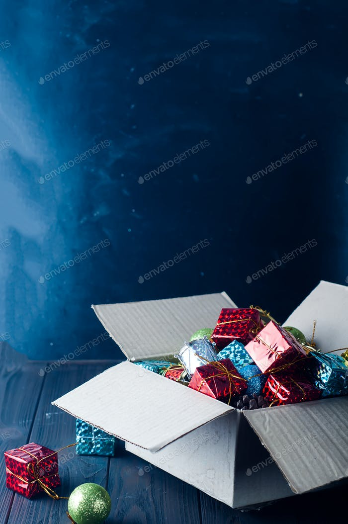 Collection of various Christmas decorations, placed into cardboard box